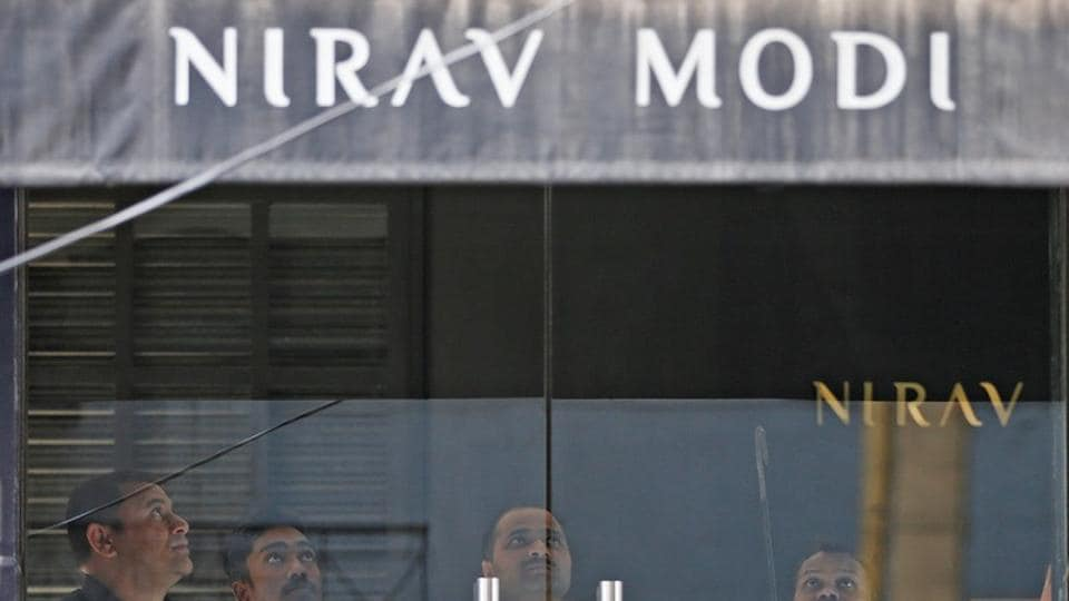 Security guards stand inside a Nirav Modi showroom during a raid by the enforcement directorate in New Delhi, on February 15.