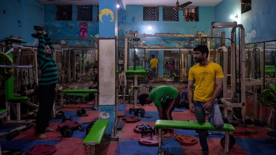 Men exercise in one of the oldest gyms in the old quarters of New Delhi on February 21. (Chandan Khanna / AFP)