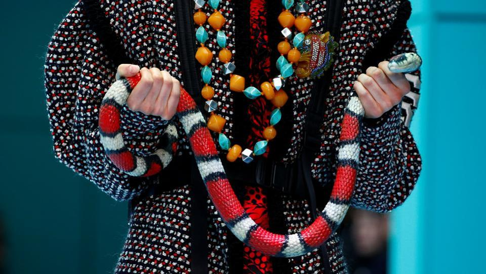 Alessandro Michele, director of Gucci introduced a wild mix of cultures and symbols, from a pagoda hat to a balaclava, a classic burgundy velvet dress to a gold lurex jacket, fine lace to the logo of the New York Yankees. (Tony Gentile / REUTERS)