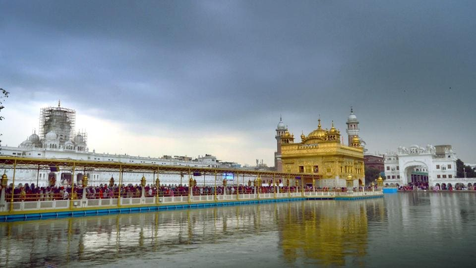 The Golden Temple in Amritsar looks surreal amid a backdrop of dark clouds on Saturday. (Sameer Sehgal/ht)