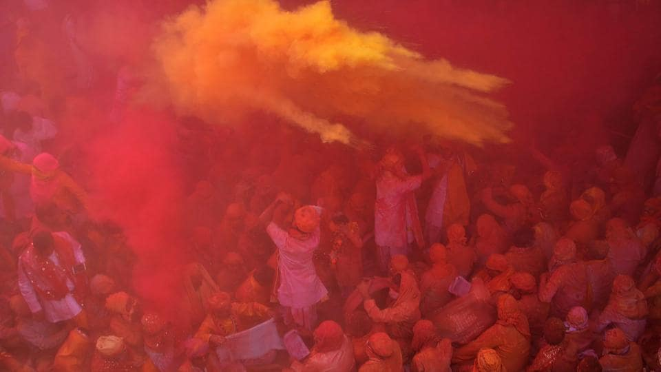 Devotees during celebration of Holi Festival at Sriji temple in Barsana, Uttar Pradesh on February 23. (AFP)