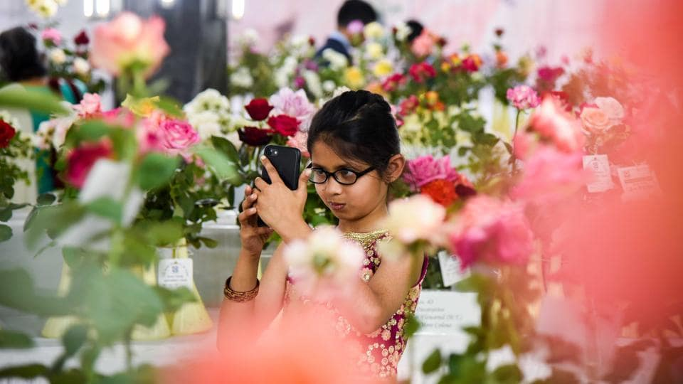 A little enthusiast takes pictures of the roses exhibited at the 101 Rose show by The Rose Society of Pune at Tilak Smarak Mandir. (Sanket Wankhade/HT PHOTO)