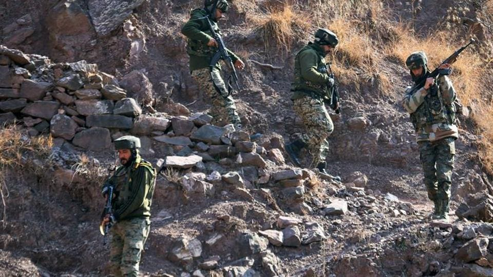 Army personnel take positions in Uri near LoC in north Kashmir on Monday.