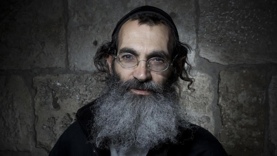 Among Orthodox Christian priests, long bushy beards are as common a sight as their long, flowing robes on the narrow, winding cobblestone streets of Jerusalem's Old City. They see a beard as a sign of devotion to God and homage to Jesus- traditionally portrayed with a beard. (Oded Balilty / AP)