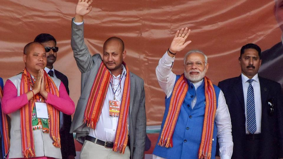 Prime Minister Narendra Modi waves during his campaign rally ahead of Meghalaya Assembly elections at Phulbari on February 22, 2018.