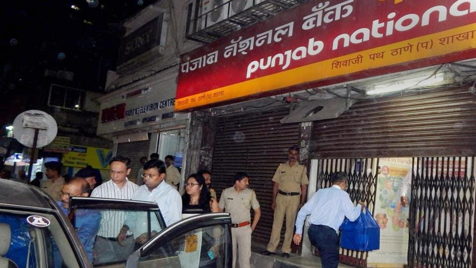 Enforcement Directorate officials outside a PNB branch in Thane after they seized cash, jewellery and bonds during a raid in connection to the Nirav Modi fraud case.