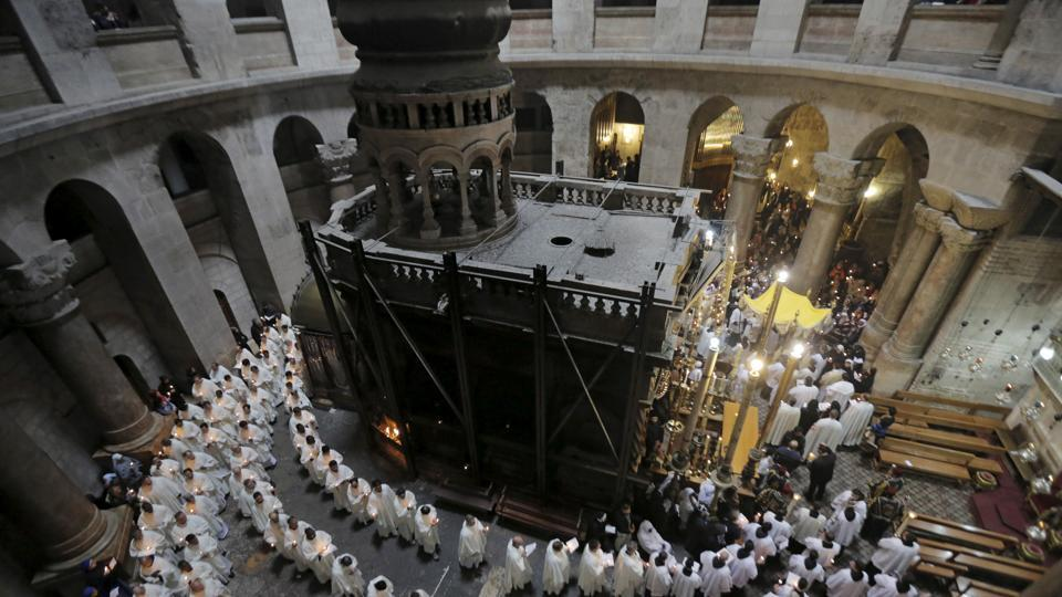 Members of the Catholic clergy hold candles during a procession at the traditional Washing of the Feet ceremony at the Church of the Holy Sepulchre in Jerusalem's Old City during Holy Week April 2, 2015.