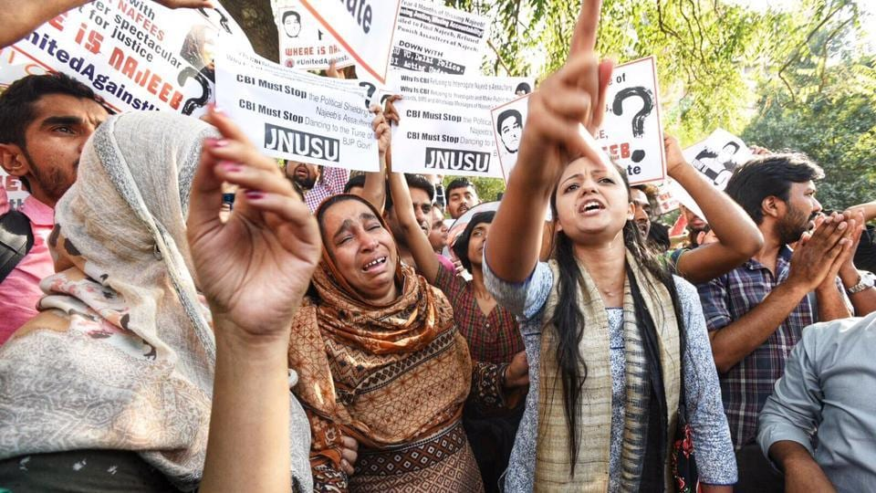 JNU students along with Najeeb's family members protest outside CBI headquarters in New Delhi on Monday. 27-year-old Najeeb has been missing since October 14-15, 2016 after a scuffle at his JNU hostel allegedly with ABVP activists the previous night. The RSS students' wing has denied any involvement in his disappearance.  (Raj K Raj / HT Photo)