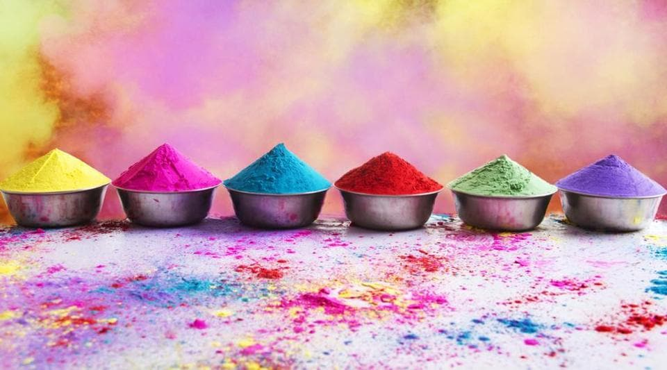 During Holi, people smear colours on each other's faces and indulge in a feast celebrating a plentiful harvest.