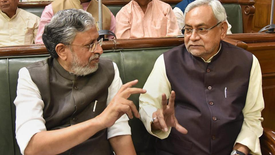 Bihar Chief Minister Nitish Kumar interacts with Deputy Chief Minister Sushil Kumar Modi during the first day of the budget session of State Assembly in Patna on Monday. (PTI)