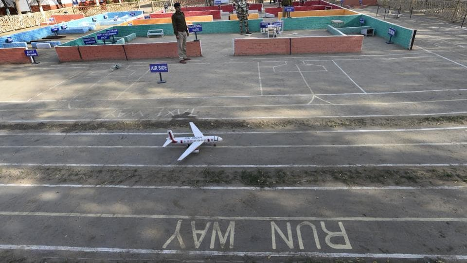 "A mock-up airport has also been constructed at the RTC to focus on airport security. ""I did not even know what an airport looks like. Over here, I have been shown the types of ticket a passenger can carry and how to read it to allow entry,"" said a constable undergoing training. The CISF is responsible for the security of 59 airports across country. (Arvind Yadav / HT Photo)"