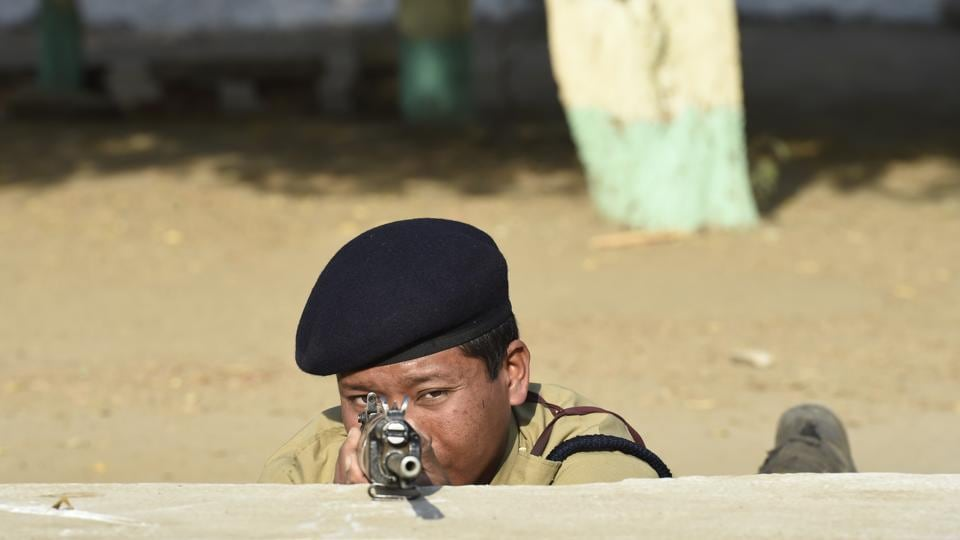 "A jawan takes aim during a training session at the centre. The jawans are given courses in anti-terrorism, VIP security, bomb disposal and gender sensitisation. ""We are also planning to have cut outs of other installations where CISF is posted,"" said Saroj Malik. (Arvind Yadav / HT Photo)"