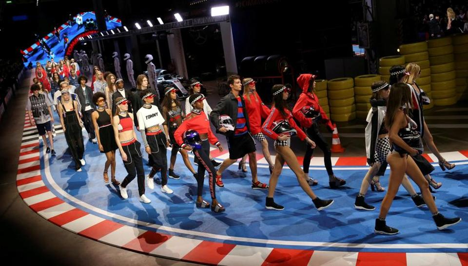Models present creations from the Tommy Hilfiger Spring/Summer 2018 collection.