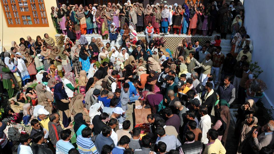 Relatives gather at the funeral of police constable Kultar Singh, who was killed in the firing at Chrar-e-Sharif shrine in Budgam, in Jammu on Monday.