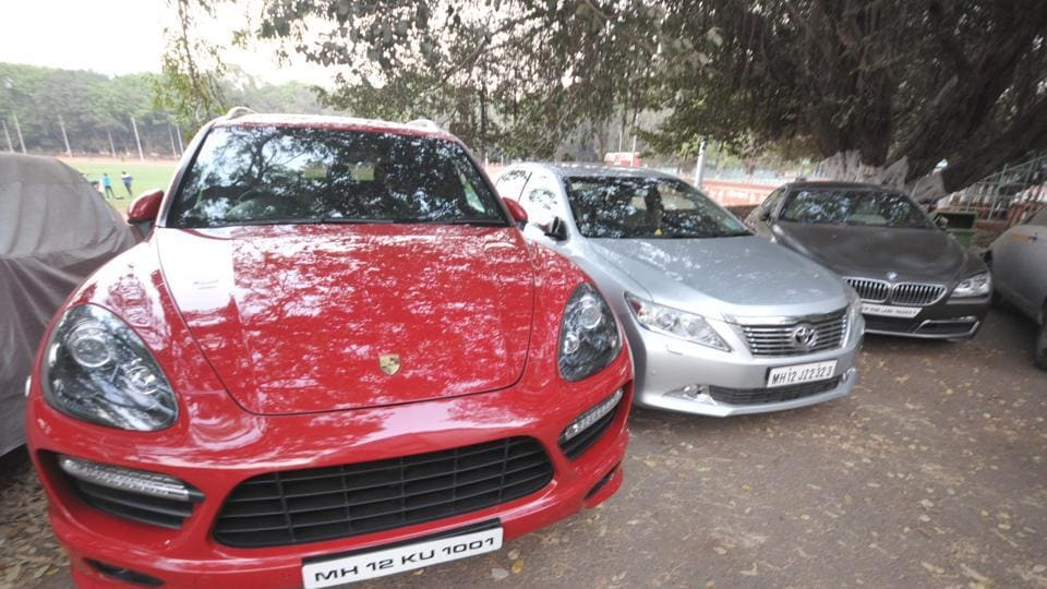 Seized vehicles of DS Kulkarni by police at Shivajinagar Police station in Pune on Monday.