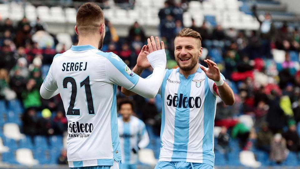 Sergej Milinkovic-Savic (L) celebrates with teammate Ciro Immobile after scoring during the Serie A match between Lazio and Sassuolo at the Mapei Stadium in Reggio Emilia, Italy on February 25, 2018.