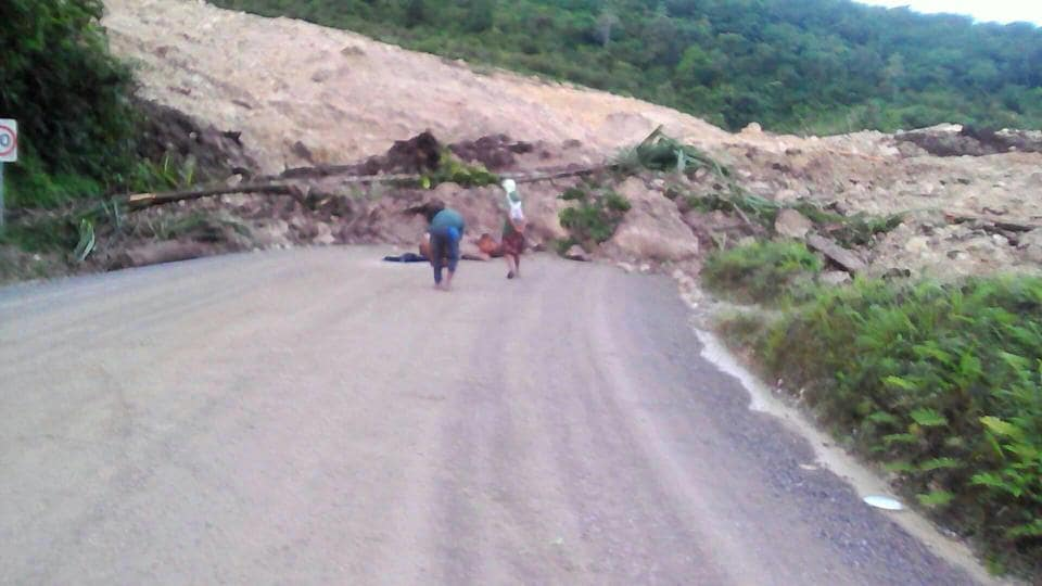 A supplied image shows locals inspecting a landslide and damage to a road located near the township of Tabubil after an earthquake that struck Papua New Guinea's Southern Highlands, February 26, 2018.