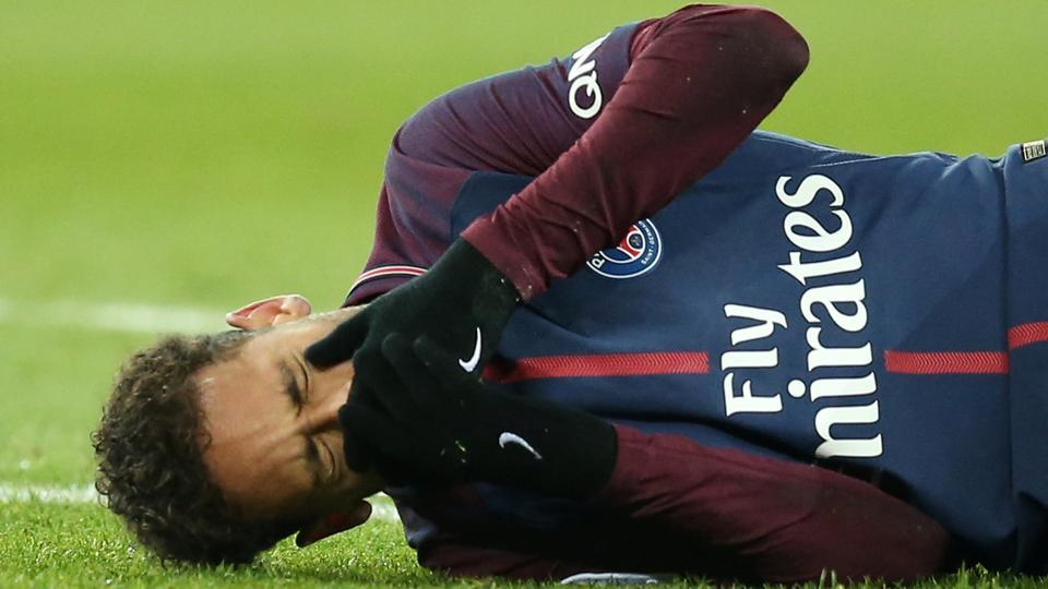 Paris Saint-Germain's Neymar lies on the pitch after sustaining an injury in a Ligue 1 match vs Olympique de Marseille at Parc des Princes in Paris on Sunday.