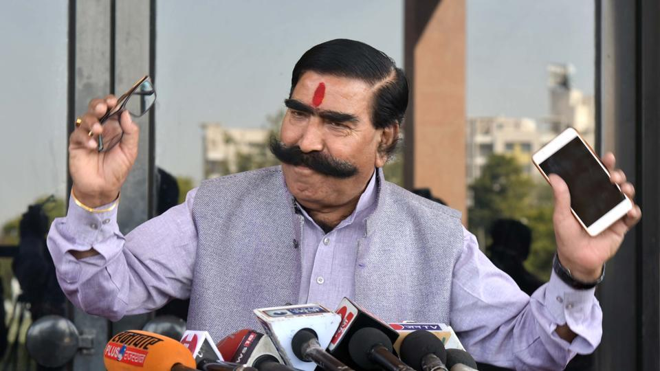 BJP MLA Gyan Dev Ahuja speaks to media persons at state assembly in Jaipur.