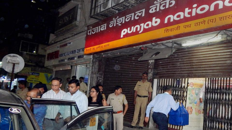 Enforcement Directorate officials outside a Punjab National Bank branch in Thane during a raid in connection with the Nirav Modi fraud.