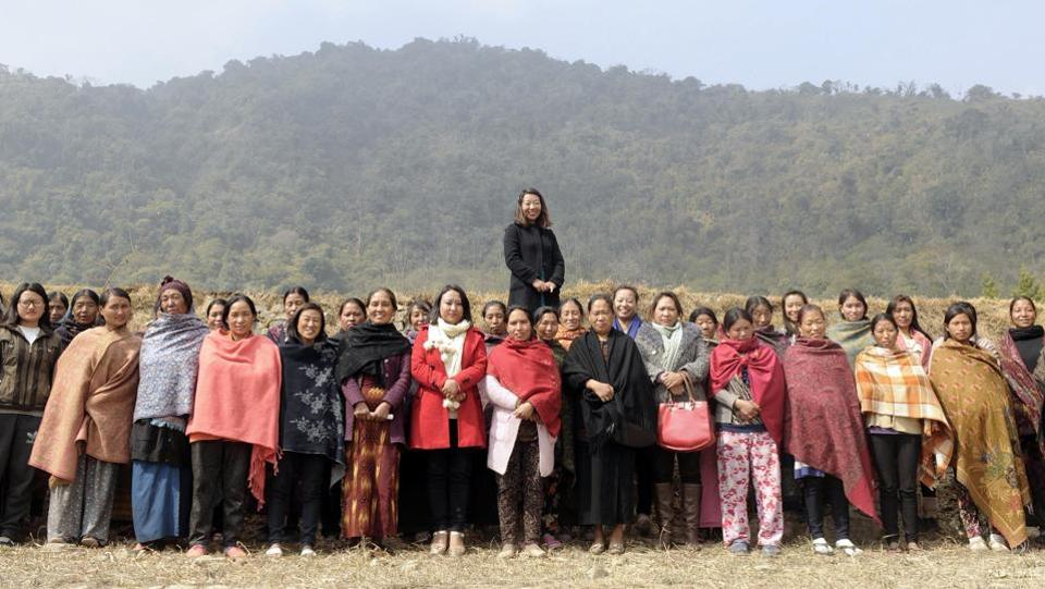 Rekha Rose Dukru, an independent candidate from the Chizami seat, with a group of women at a village in Phek district. 35-year-old Dukru is one of five women candidates trying to become the first woman MLA in the state. (Samir Jana / HT Photo)