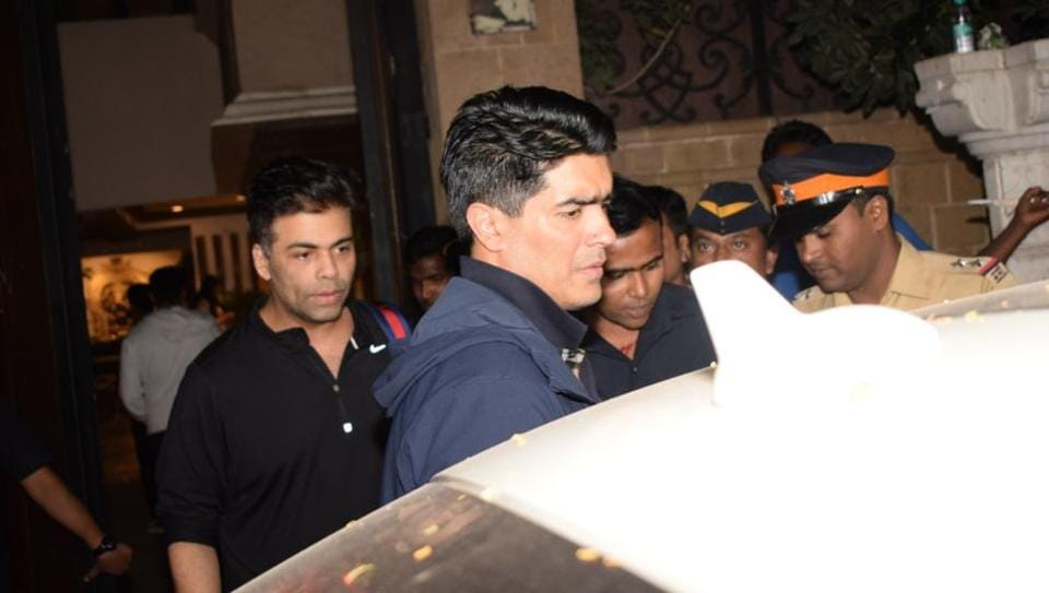Filmmaker Karan Johar and fashion designer Manish Malhotra at actor Anil Kapoor's residence to meet the grief struck Kapoor family after sudden demise of actress Sridevi.