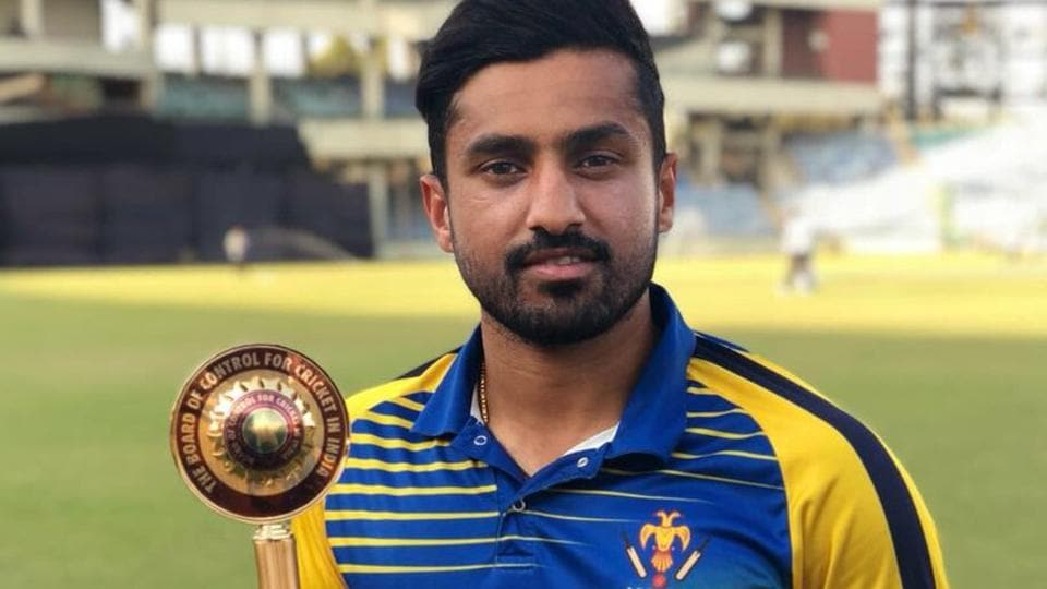 Karnataka cricket team skipper Karun Nair with the Vijay Hazare Trophy after leading his side to victory in the final vs Saurashtra in New Delhi on Tuesday.