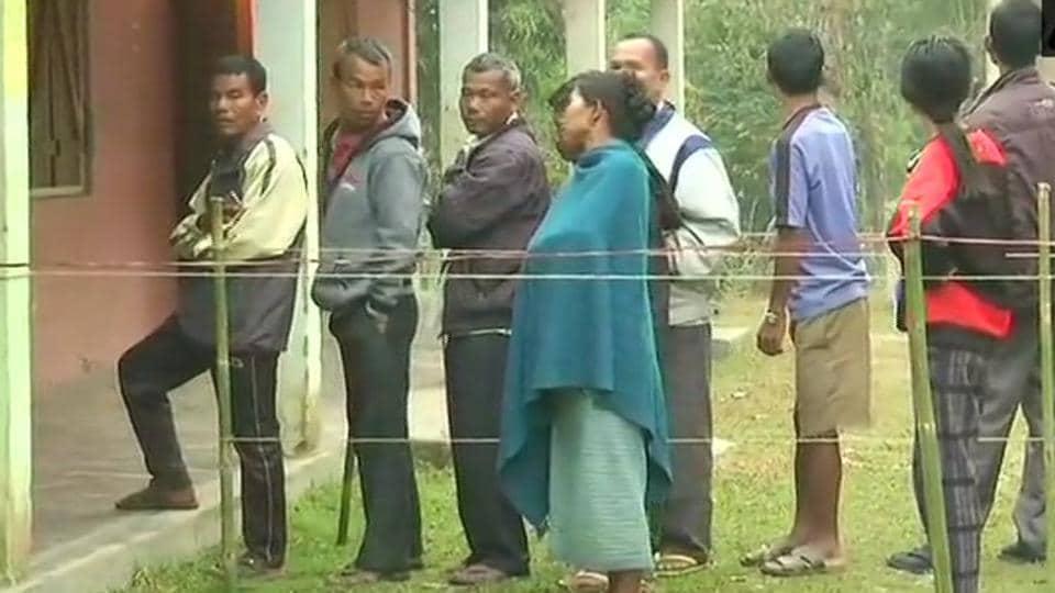 Voters queue up outside Chengkompara-25 polling station in Ampatigiri.