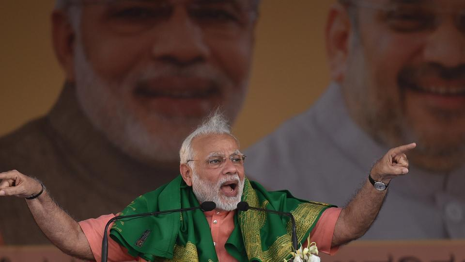 Prime Minister Narendra Modi addresses a farmers' convention in Davangere, Karnataka, on Tuesday.