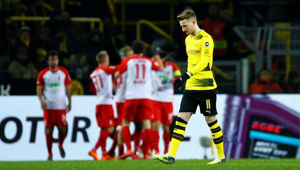 Borussia Dortmund's Marco Reus looks dejected after Augsburg's Kevin Danso scores their first goal on Monday.