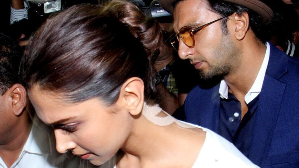 Bollywood actors Deepika Padukone (L) and Ranveer Singh arrive at the home of Anil Kapoor following the death of Sridevi. (Sujit Jaiswal / AFP)