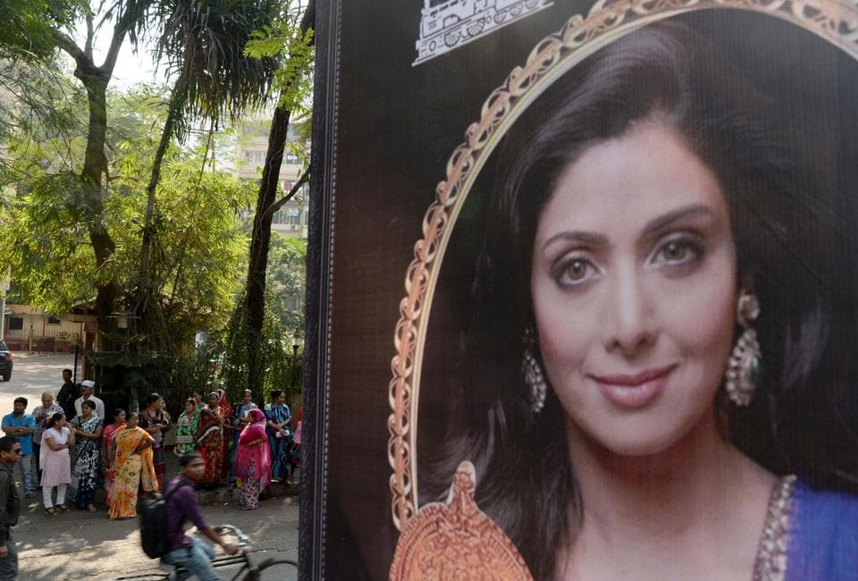 A picture of Bollywood actor Sridevi Kapoor is seen put up outside her residence in Mumbai. Her mortal remains are expected to reach India on Tuesday, as the family has received her body from the authorities.The probe launched into her death by Dubai's prosecution department has been closed. (Punit Paranjpe / AFP)