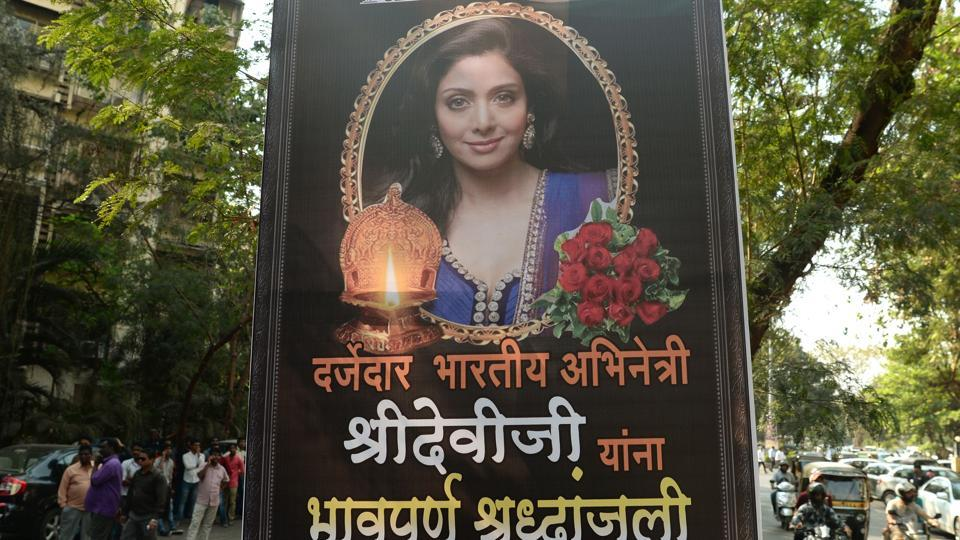 A picture of Bollywood actor Sridevi Kapoor is put up outside her residence in Mumbai on February 26, 2018, following her death.