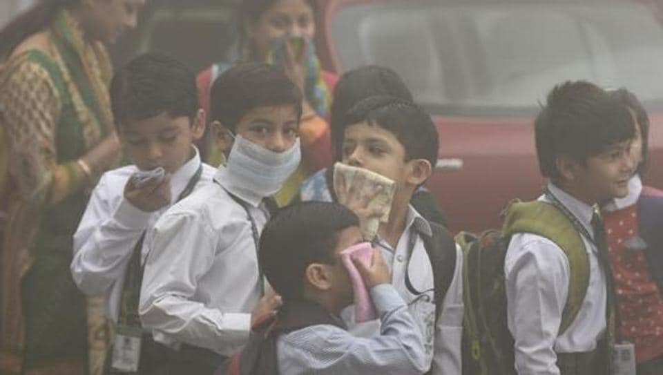 Students wait for a school van in the morning at Mayur Vihar in New Delhi, in November 2017. Air quality dips  severely during the winter months owing to crop burning at the start of the season.
