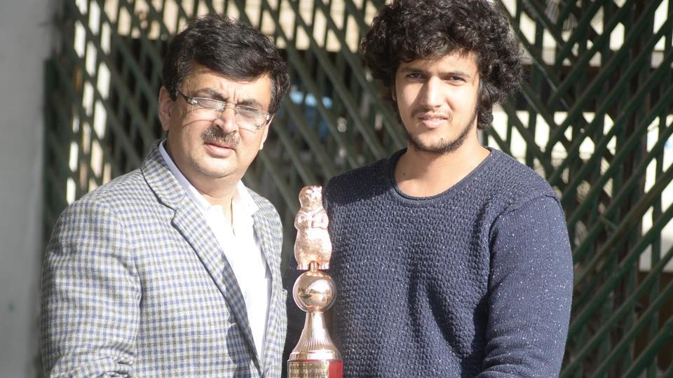 Utsav Arora (right) with his father Yogesh Arora showing his bronze award in Amritsar on Monday.