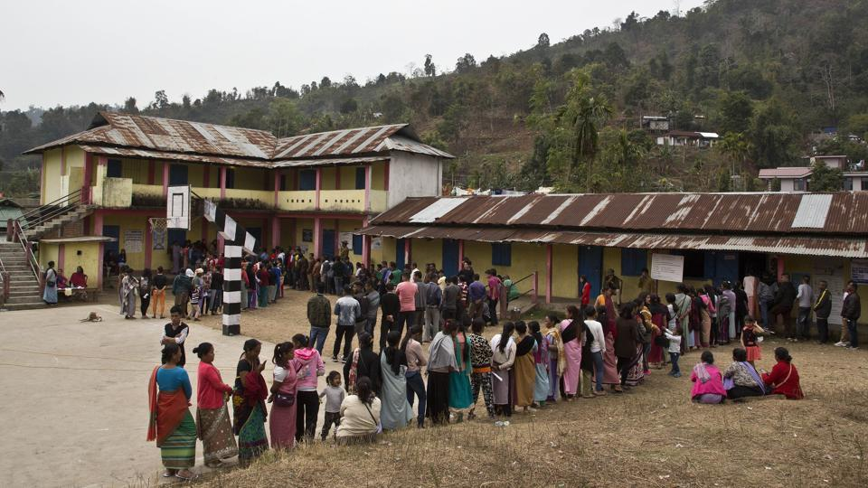People stand in queue to cast votes outside a polling station during the Meghalaya state assembly election in Nongpoh. Elections are underway for 59 seats each in Meghalaya and Nagaland. The counting of votes is scheduled for March 3, along with Tripura, which went to the polls on February 18. One person was reported injured in a grenade blast in a polling booth in Nagaland. (Anupam Nath / AP)