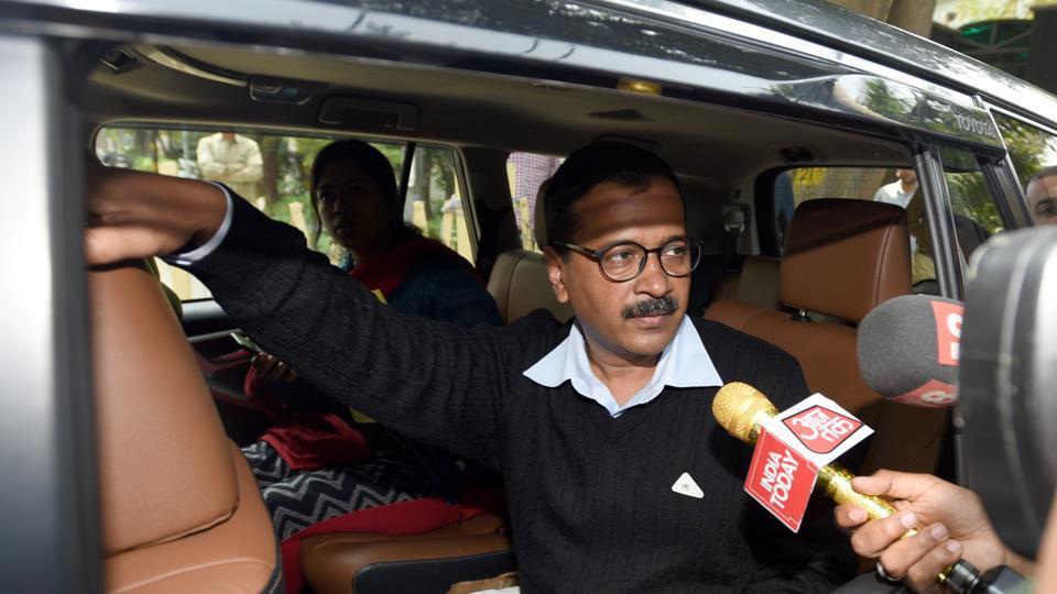 Delhi CMArvind Kejriwal speaks to a TVjournalist.