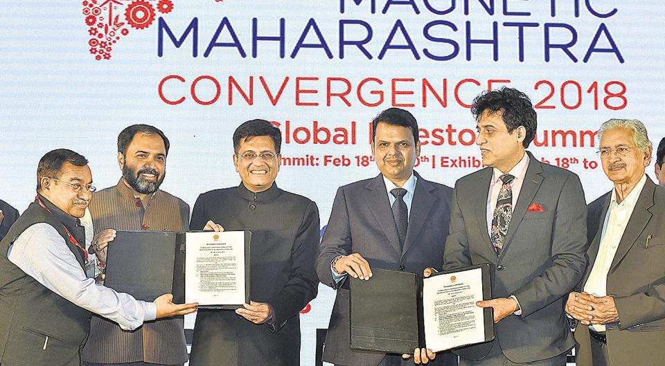 Dignitaries during an MoU signing ceremony at Magnetic Maharashtra Convergence Summit 2018, in Mumbai on Tuesday.