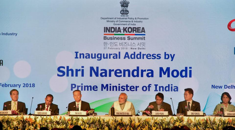 Prime Minister Narendra Modi with Union Minister for Commerce and Industry Suresh Prabhu and others during India-Korea business summit in New Delhi. Speaking at the summit, Modi on Tuesday said India is one of the most open global economies and is ready to do business with the world. (PTI)