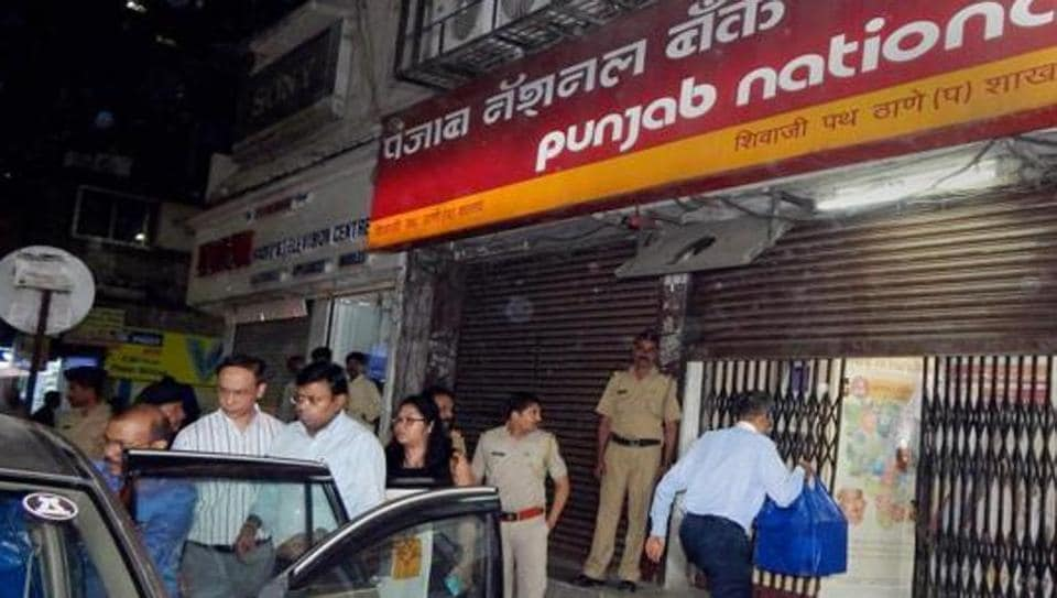Enforcement Directorate (ED) officials outside a Punjab National Bank (PNB) branch in Thane after they seized cash, jewellery and bonds worth several crores during a raid in relation to the Nirav Modi-PNB fraud case on February 20, 2018.