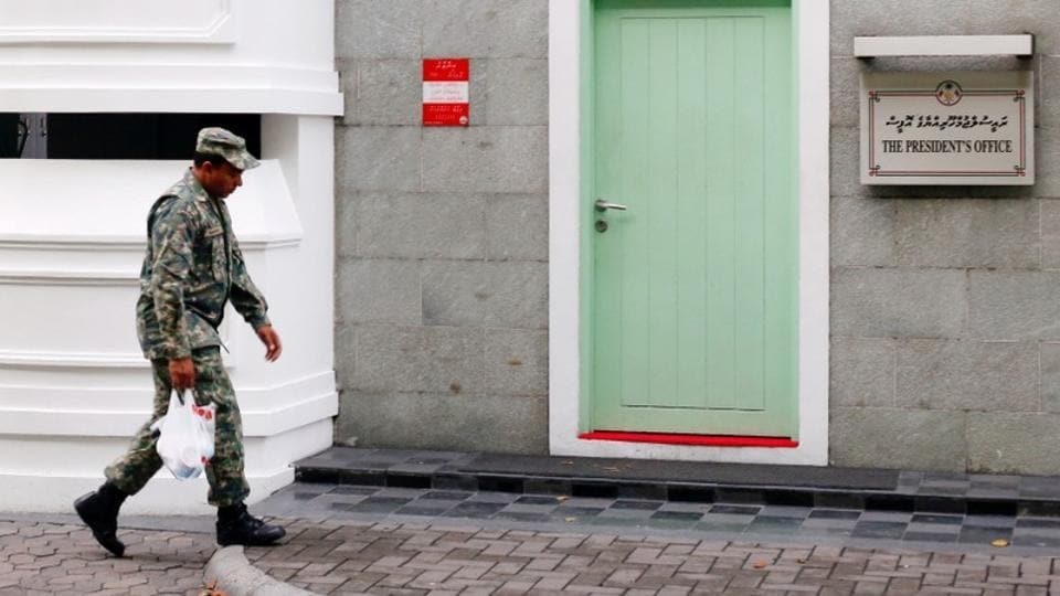 A Maldives National Defence Force soldier walks past the president's office building in Male, Maldives February 6, 2018.  Maldives has declined India's invitation to participate in the