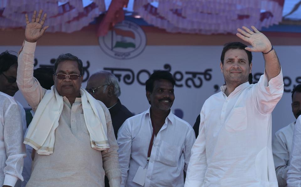 Congress president Rahul Gandhi and Karnataka CMSiddaramaiah during a public meeting in Jamakhandi, Karnataka.