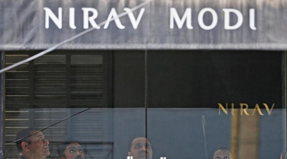 Security guards stand inside a Nirav Modi showroom during a raid by the Enforcement Directorate on  February 15, 2018.