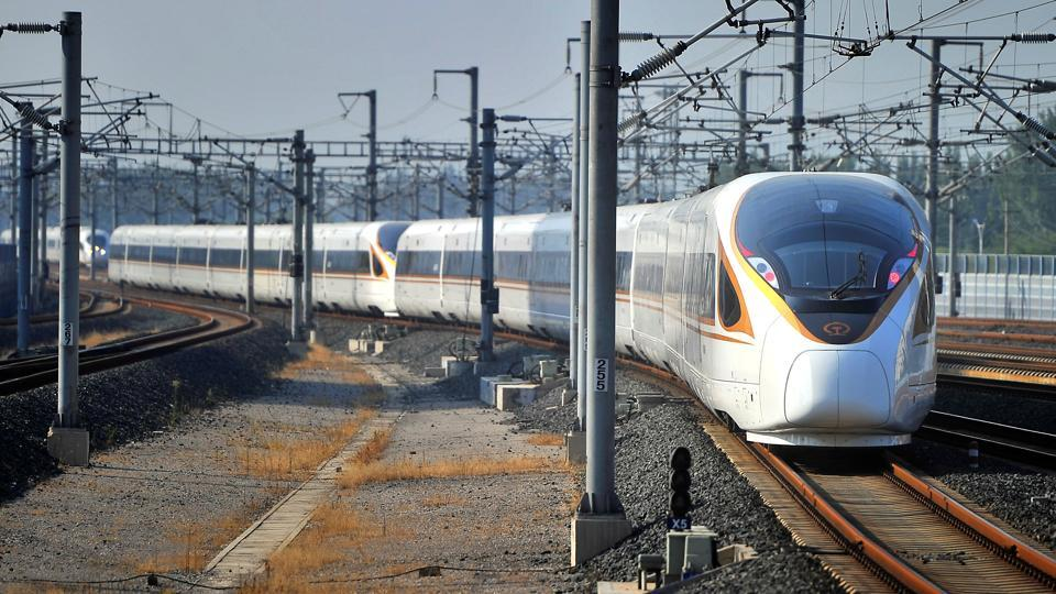 A Fuxing bullet train, travelling from Beijing to Shanghai, arrives at Jinan West Railway Station.