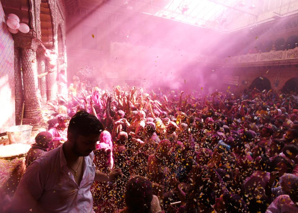 Devotees smear each other with coloured powder during Holi celebrations at Banke Bihari temple in Vrindavan on Tuesday. (Sonu Mehta / HT Photo)