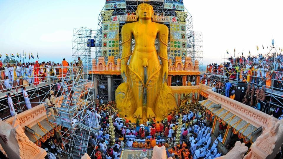The statue was bathed by devotees using an 'attanige' (huge scaffolding) erected for the purpose, with libations such as water, coconut water, sugarcane juice, milk, rice flour, turmeric paste and precious stones, amidst the chanting of hymns. (PTI)