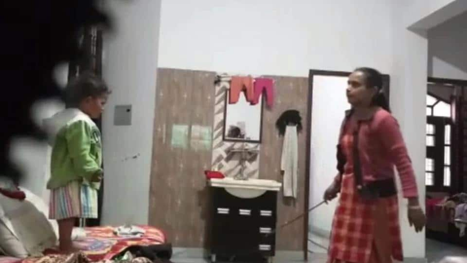 A video grab showing the maid with a wooden stick.