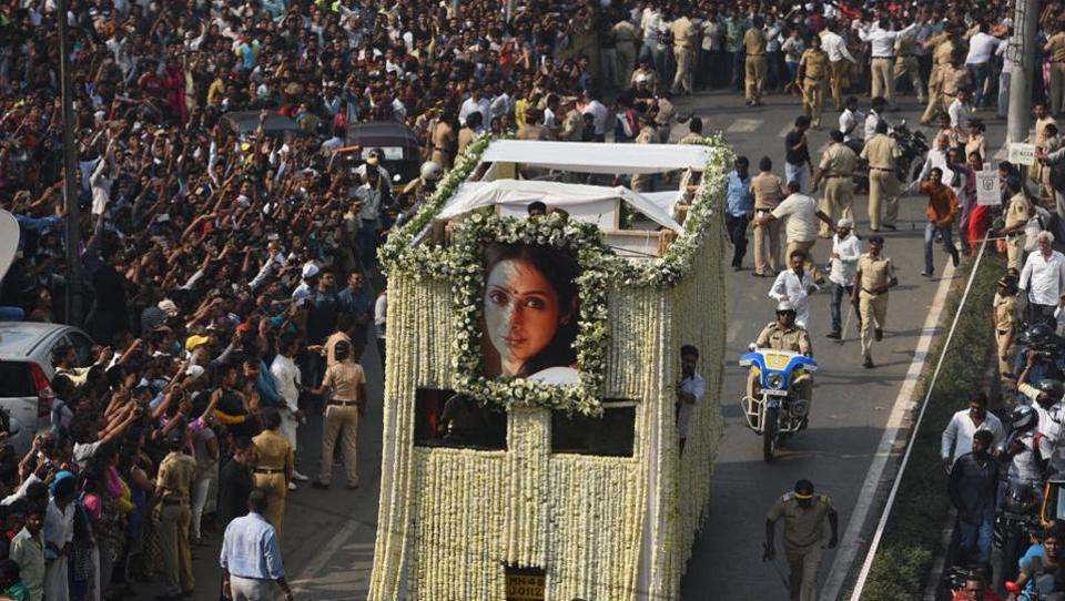 Bollywood actor Sridevi was cremated with state honours at Mumbai's Vile Parle Seva Samaj Crematorium on Wednesday. The actor was draped in a tricolour on her last journey as her flower-covered cortege left Celebration Sports Club in Lokhandwala, Mumbai. (Satish Bate/ HT Photo)