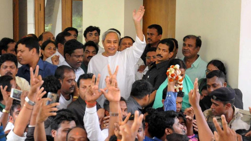 Odisha chief minister and BJD chief Naveen Patnaik waves to supporters after the party candidate, Rita Sahu, won Bijepur by-election, in Bhubaneswar on Wednesday.