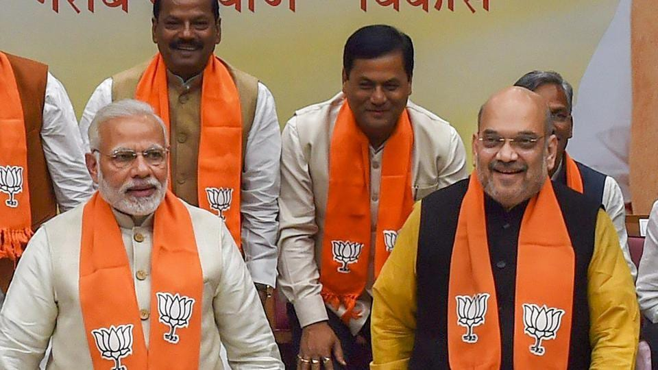Prime Minister Narendra Modi and BJP president Amit Shah with chief ministers of BJP-ruled states at party headquarters in New Delhi on Wednesday.